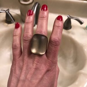 Lucite ring carved into a luminous block shape